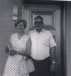 dick & mary at a front door