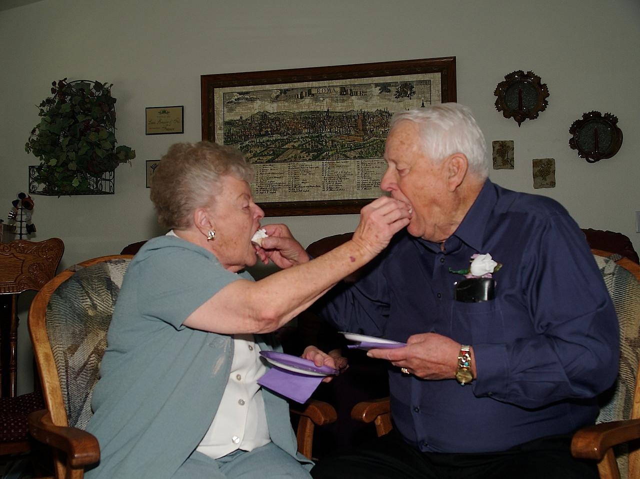 Feeding each other cake.