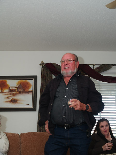 Cw ( a friend of Howard's) giving a toast.