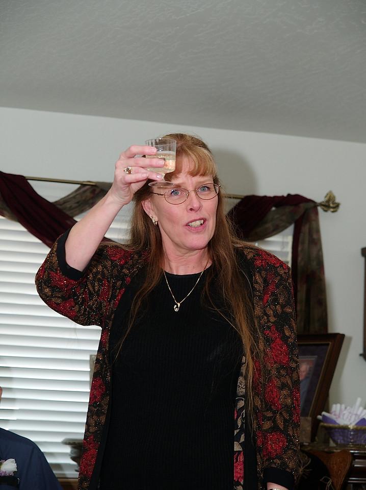 Barbara (Tony's mom) giving a toast.