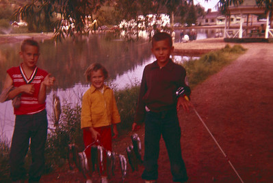 Chris, Rick and Tia Peterson with their fish catch from a stocked pond at Green Mountain Falls, CO.  Around 1958.