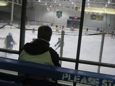 Ice hockey is one of Aaron's passions!   Chris watches as Aaron practices.