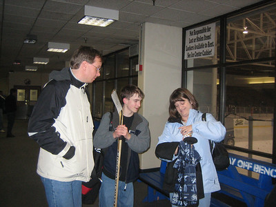 Chris, Aaron, and Heather at hockey rink
