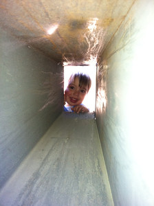 Hi Alec!    (Looking through channels on the side of the big bear-proof trash bins)