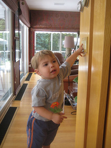 """Pushing light switches is a favorite activity. On, off, on, off, on...    """"Light!"""" he says again, and again."""