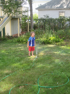 so I set up an old sprinkler at home.    This is the same sprinkler I used to jump over as a kid!