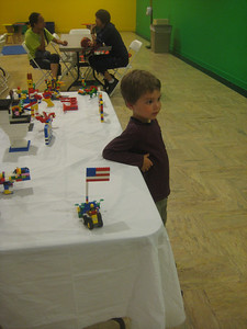 Mateo made a vehicle (foreground) and Tonya created a structure with flag.
