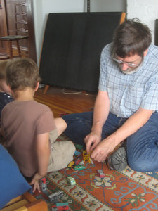 Back in our house, Ken shared his box of old Matchbox cars and trucks -- a real treat.