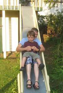 I gave Mateo a ride down the slide  (which was a bit too hot on the upper section for bare skin to touch).