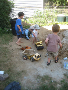 Back at home, we invited the neighbors to come play in the dirt  (a by-product of our cellar hatchway project). Kiernan and Liam brought big trucks for earth moving; Ken contributed a truck from his childhood, and a tractor with trailer.