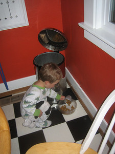 January 10, 2008. Teo measuring out food for Hiro.