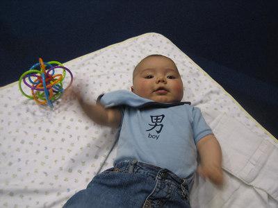 Bilingual boy in bilingual shirt at bilingual convention