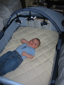 Mateo's portable bed fit right between our beds