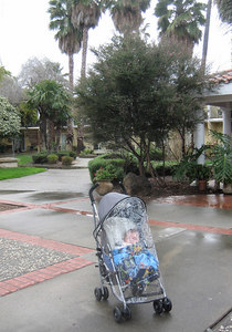 Mateo ready for travel in  rain; courtyard at our Hyatt hotel