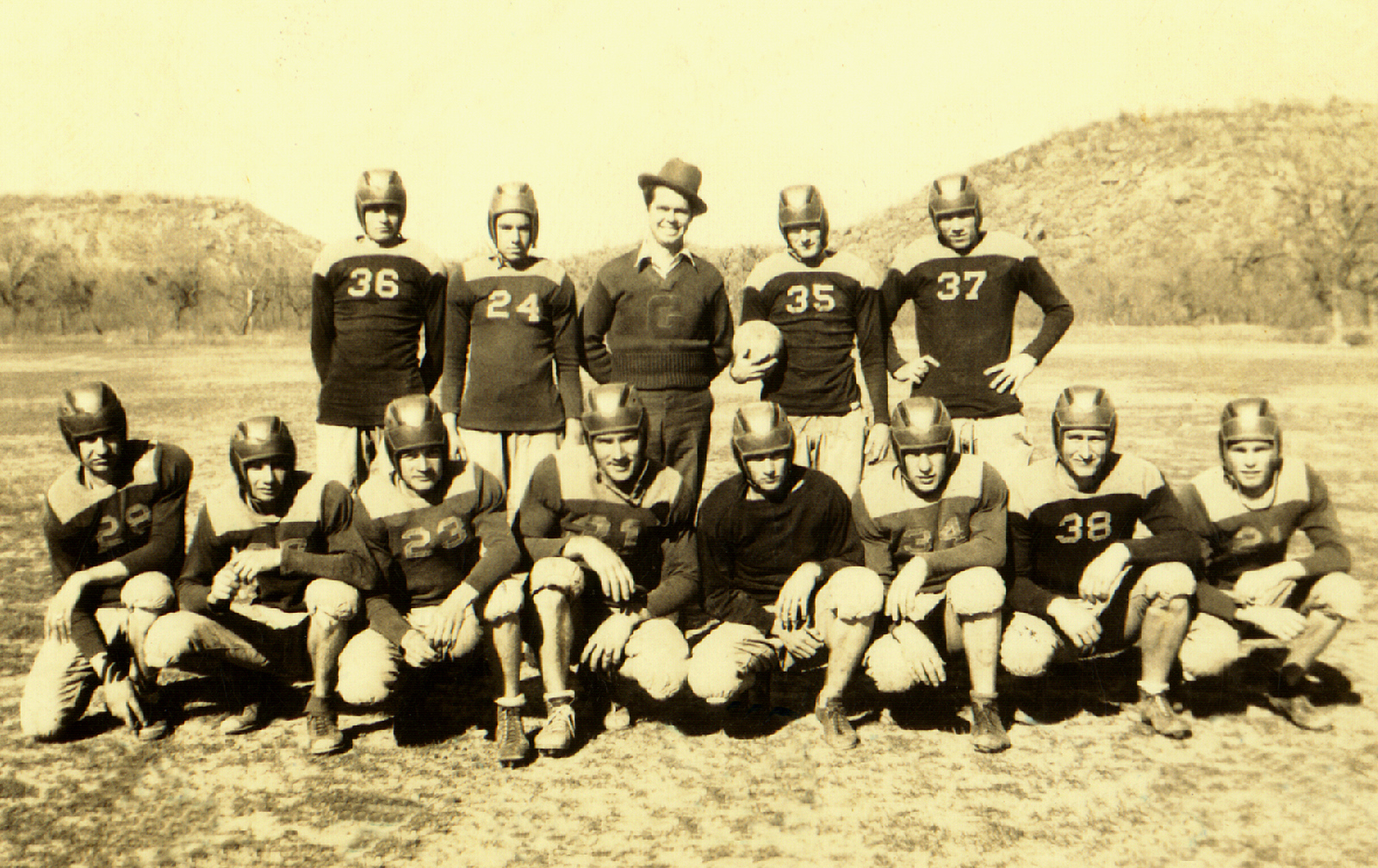 Picture taken on the Gordon High School football field in Gordon, Texas. Notice the harsh playing surface.The coach (center with hat) introduced football to Gordon High. Edwin Gibson Sr. is number 37. [5222010jg4]