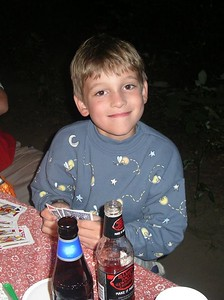 Sweet Sam the six year old card player.  (Those beers are not his).
