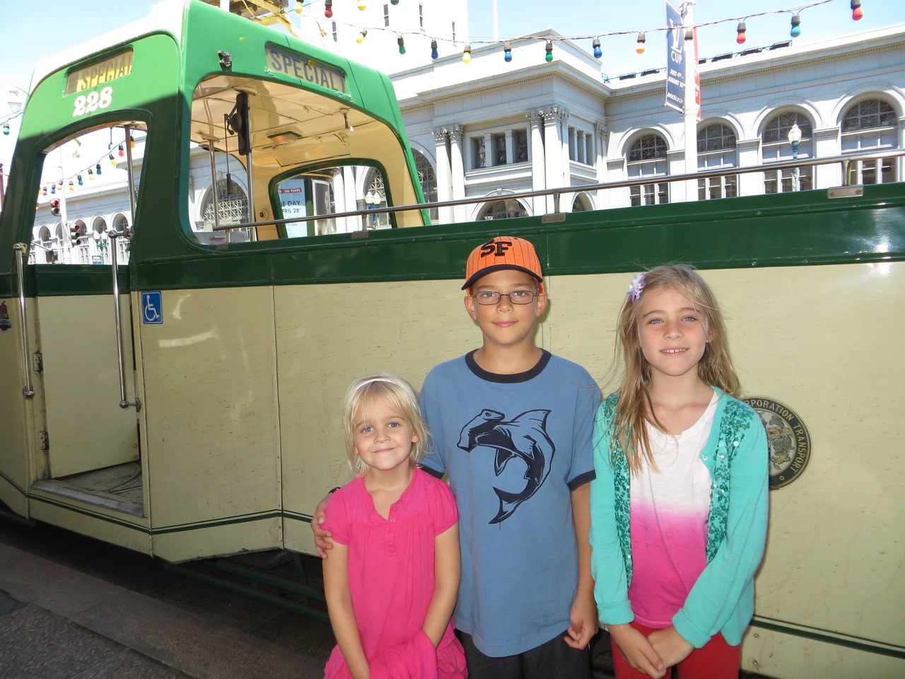 Allegra, Austin and Sofia in front of our trolley