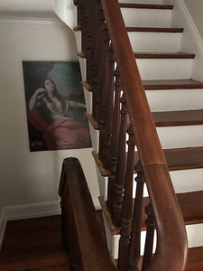 Looking down the stairs from the second floor.  The painting is an original that Greg bought.