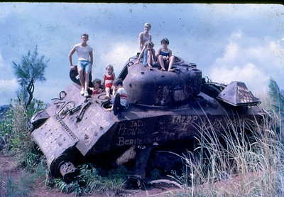 Kent, Vicki, Kent, Linda, Mary, Terry and Lenore Lansing on Tank at Tank Farm Guam