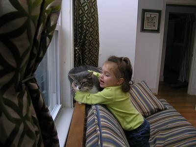 Squeezing the poor cat.