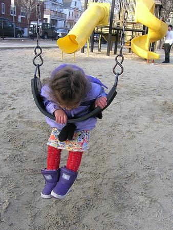 Guen swinging by herself.