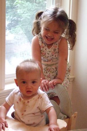 Guen climbs behind her sister.