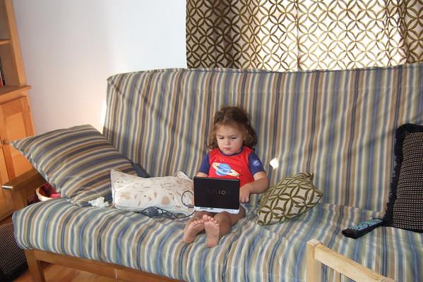Guen checks her e-mail.