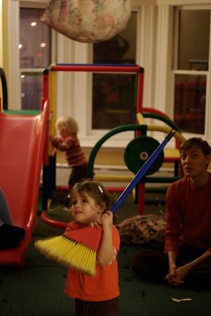 Guen takes her whack at Jovan's birthday piñata.