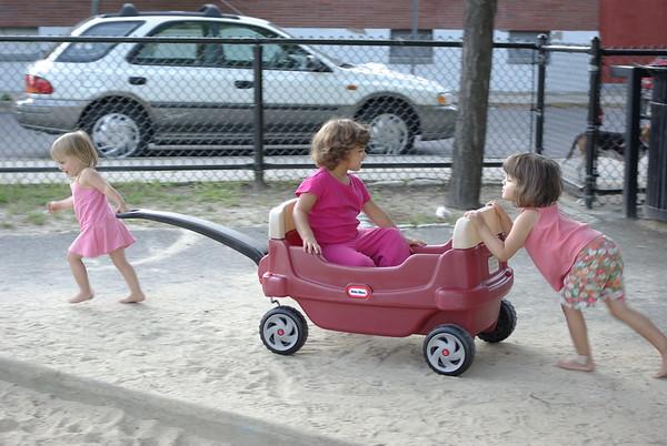 Guen and Anya transport Caitlin.