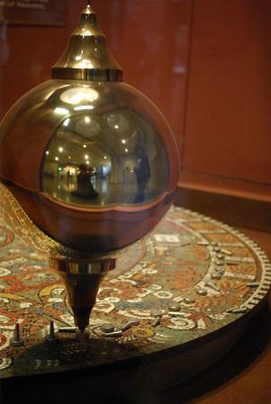 The pendulum clock.