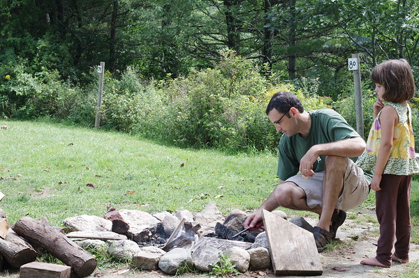 Guen learns about fire.