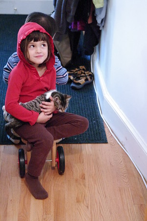 Guen and Max take Phoebe for a ride around the house.