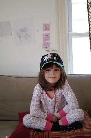 Guen (jealously) models Anya's new hat.