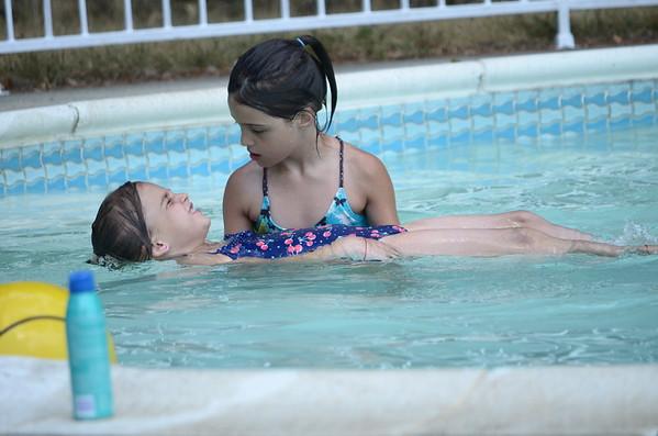 Guen helps teach Anya to float.
