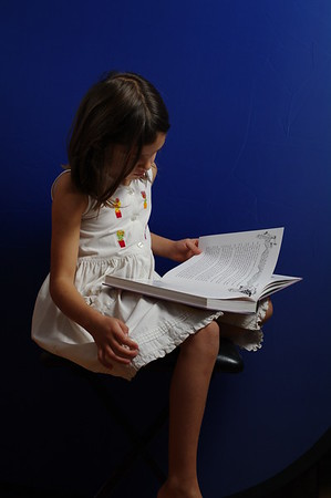 She's reading Pippi Longstocking.