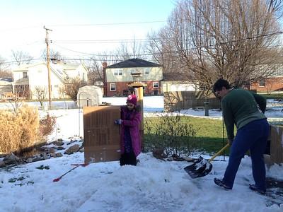 Grandma and Guen build a miniature sledding hill.
