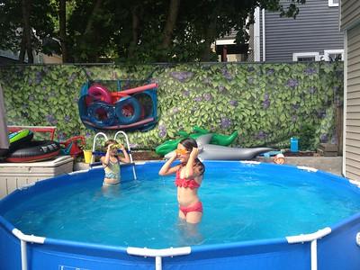 In the neighbors' backyard pool.
