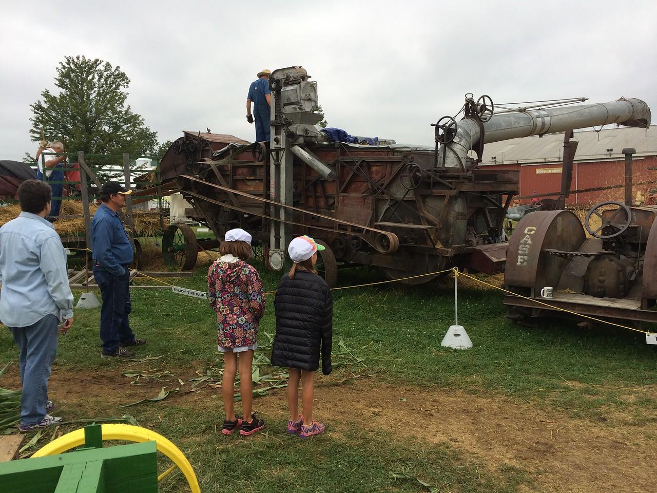 Watching hay baling at the Indiana State Fair.