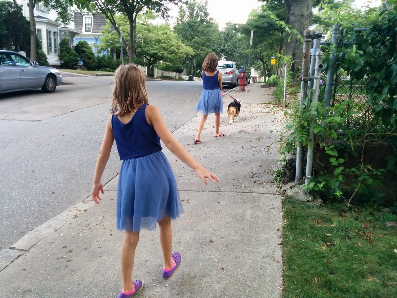 Guen walks the dog while Anya carefully keeps her distance.