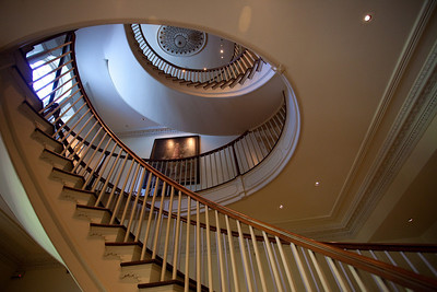 The spiral staircase going up through the oval in the ceiling.