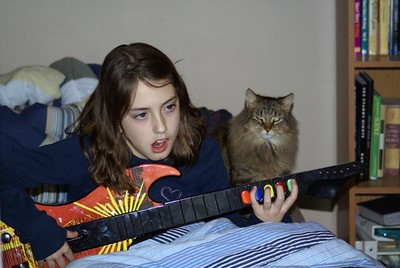 Bea plays guitar under Tu Tu's tutilege!