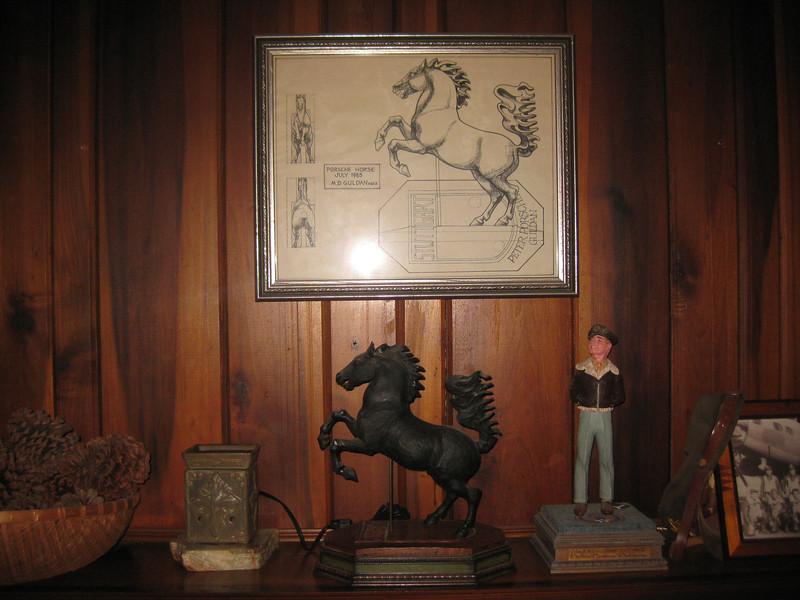 By 1985, MD was heavily into wood carving.   Based on a brief glance at the hood badge on my Porsche she perfectly replicated the horse in a foot tall wood carving and accompanied it with the drawing positioned over it which hangs over our fire place to this day.
