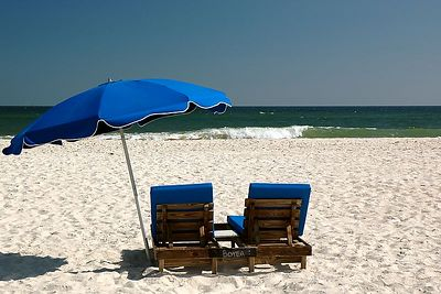 Chairs and umbrella look inviting.