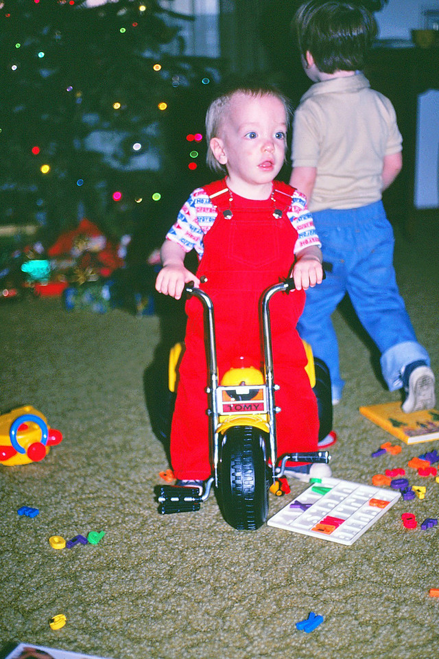 Jason on his new Tomy trike, 1981