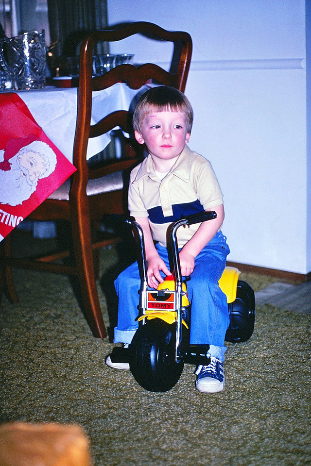 David trying out the Tomy trike Xmas, 1981
