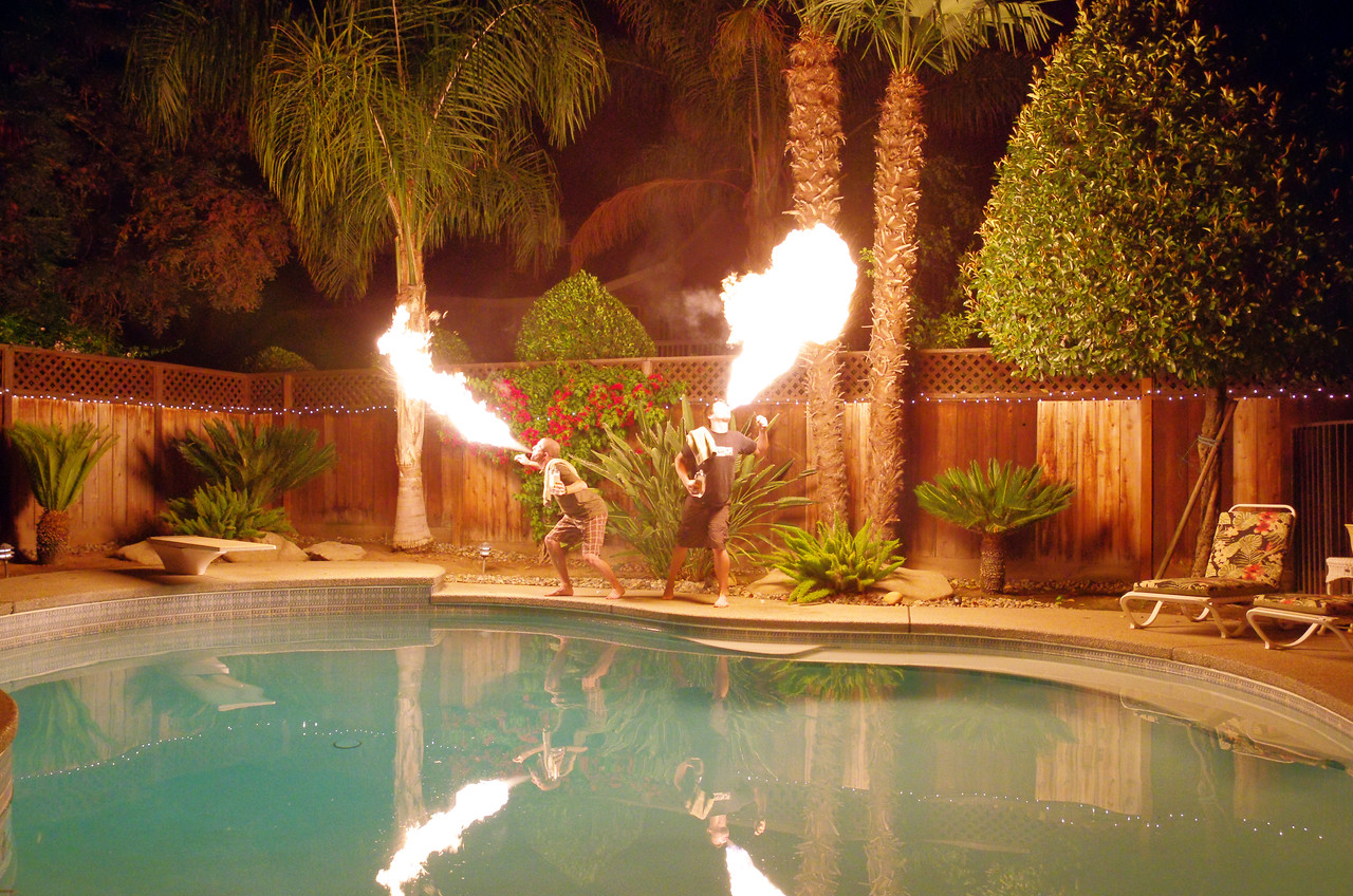 My Brother and a friend blowing some Fire in my Parent's Backyard.
