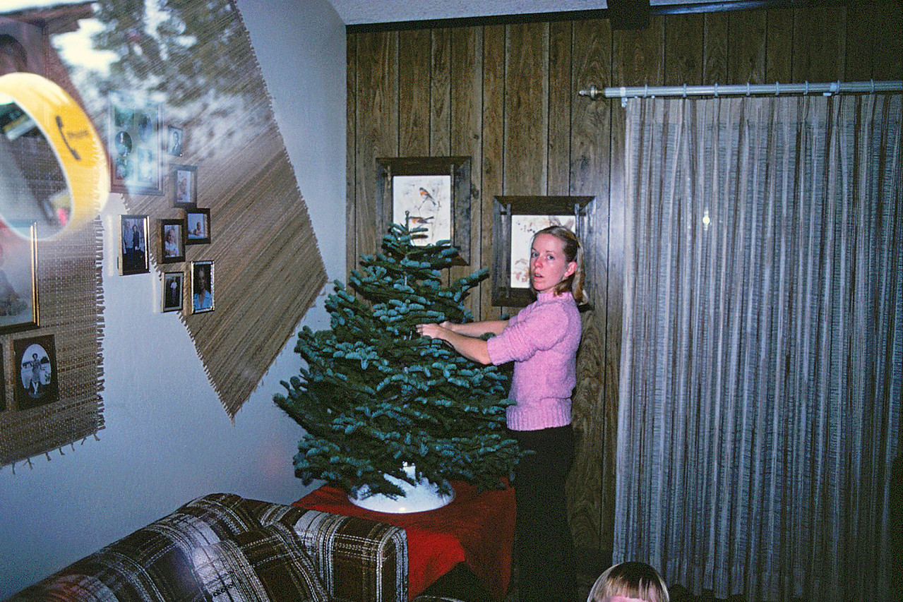 Mom decorates the Christmas Tree while she thinks about that phone call she made earlier, 1982