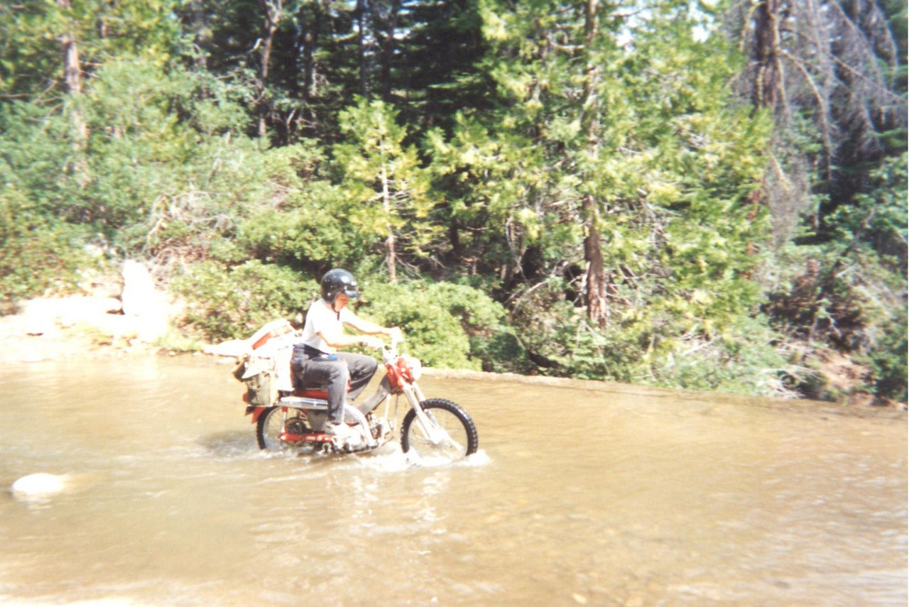 David crosses the Creek on his Trail 90, 1993