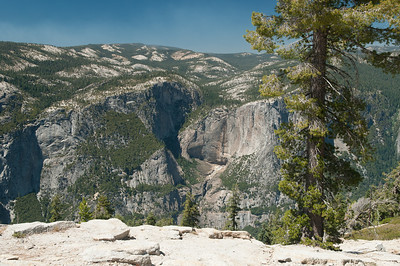 Just to the left of the pine tree in the foreground is Upper Yosemite Falls.  There is no water in it (the first time I've seen it that way) because of the dry winter.