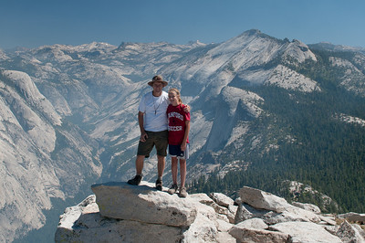 We made it to the top!  Standing on the edge of Half Dome with Cloud's Rest and the Tuolumne high country in the background.